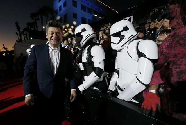 "Actor Andy Serkis (L) walks past fans dressed as ""Storm Troopers"" as he arrives at the premiere of ""Star Wars: The Force Awakens"" in Hollywood, California December 14, 2015. REUTERS/Mario Anzuoni"