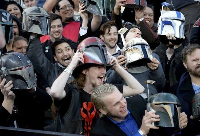 "Fans hold up helmets at the premiere of ""Star Wars: The Force Awakens"" in Hollywood, California, December 14, 2015. REUTERS/Kevork Djansezian"
