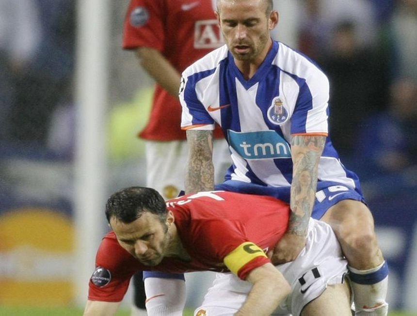 Manchester United's Ryan Giggs is held by Porto's Raul Meireles during their Champions League soccer match in Porto