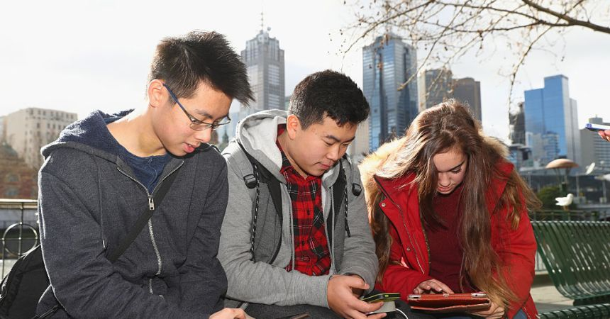 MELBOURNE, AUSTRALIA - JULY 13:  Youths play the Pokemon Go game on their phones at Southgate on July 13, 2016 in Melbourne, Australia. The augmented reality app requires players to look for Pokemon in their immediate surroundings with the use of GPS and internet services turning the whole world into a Pokemon region map. The hugely popular app has seen Nintendo shares soar following its limited release in the US, Australia and New Zealand on July 6.  (Photo by Robert Cianflone/Getty Images)