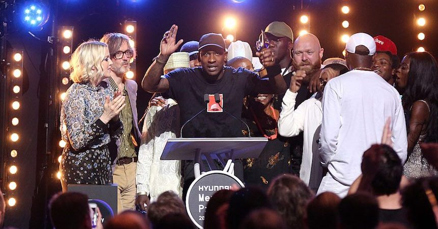 LONDON, ENGLAND - SEPTEMBER 15:  Joseph Junior Adenuga aka Skepta accepting the award after being announced the winner of the Mercury Prize 2016 at the Hyundai Mercury Prize 2016 at Eventim Apollo on September 15, 2016 in London, England.  (Photo by Tim P. Whitby/Getty Images)