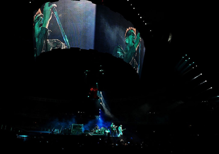 SAN SEBASTIAN, SPAIN - SEPTEMBER 26: Guitarist The Edge and lead singer Bono of U2 perform onstage during the U2 360 Tour concert at the Estadio Anoeta on September 26, 2010 in San Sebastian, Spain. (Photo by Jasper Juinen/Getty Images)