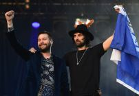 LEICESTER, ENGLAND - MAY 16:  Tom Meighan and Sergio Pizzorno of Kasabian celebrate during the Leicester City Barclays Premier League Winners Bus Parade on May 16, 2016 in Leicester, England.  (Photo by Laurence Griffiths/Getty Images)