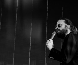 LOS ANGELES, CA - AUGUST 28:  (EDITORS NOTE: This image has been converted to black and white.)   Father John Misty performs onstage during FYF Fest 2016 at Los Angeles Sports Arena on August 28, 2016 in Los Angeles, California.  (Photo by Kevin Winter/Getty Images for FYF)