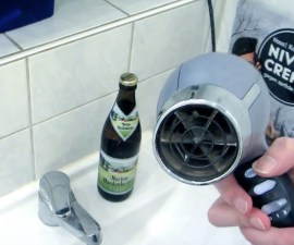 Abrir cerveza con una secadora