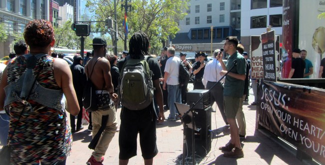 Jacob preaches while police arrest heckler at 5th St. and Market.