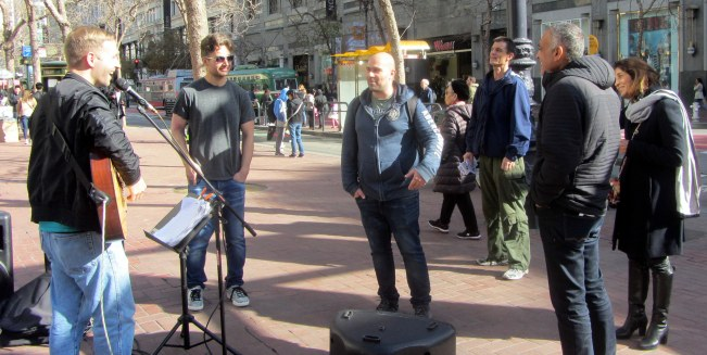 Cal sings at 5th and Market St.