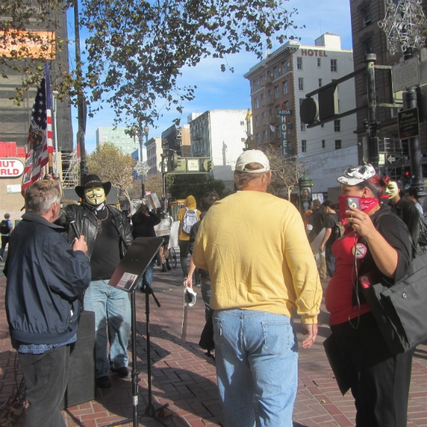"JOHN PREACHES TO ""ANONYMOUS"" HECKLERS AT 7TH ST AND MARKET."