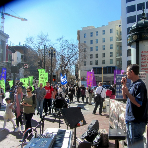 MIKE PREACHES AS FALUN GONG MARCH PASSES US AT 5TH AND MARKET.