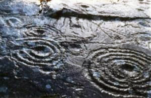 Petroglyphs on rock face at Derrynablaha, County Kerry