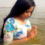 Poonam Pandey takes dip in Holy Water