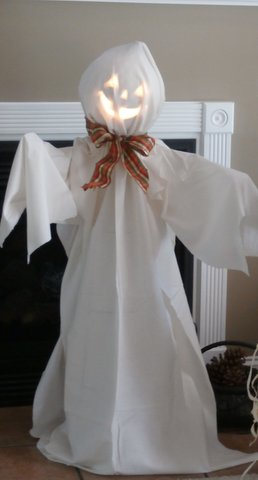 Make a jack-o-lantern ghost tomato cage craft for Halloween home decor.