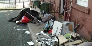 Flytipping from a Beeston property onto a Belle Isle street