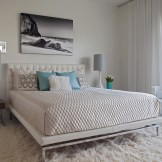 Master bedroom with white leather king bed