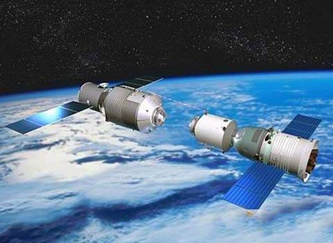 Artist's conception of the Tiangong-1 space station during rendezvous and docking with a Shenzhou spacecraft (Credit: Reuters).