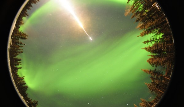 A fisheye photo taken by an automated camera near the entrance gate at the Poker Flat Research Range in Fairbanks, Ala., as a suborbital rocket launches into the northern lights on a science mission on Feb. 18, 2012 (Credits: Donald Hampton/Space.com).