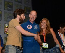 """The Big Bang Theory"" star Simon Helberg (left), XCOR Chief Test Pilot/former NASA astronaut Rick Searfoss and Mercedes Becerra of Paso Robles, Calif., winner of the trip to space given away at ""The Big Bang Theory"" panel at Comic-Con 2012 on July 13 (Credits: ©WBEI. All Rights Reserved)."