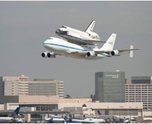 The space shuttle Endeavour, piggybacked atop of NASA's Shuttle Carrier Aircraft, flies over the Los Angeles International Airport on Sept. 21, 2012. Endeavour will be placed on display at the California Science Center (Credits: Getty Images/Michal Czerwonka)