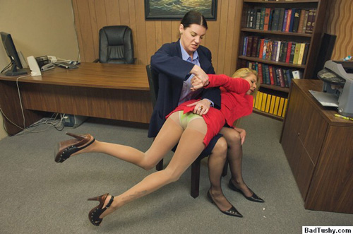 Ms Evans' skirt is lifted up and she is spanked over her pantyhose