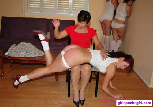 Strict tutor, Miss Morgan, spanks Veronica Ricci over her knee