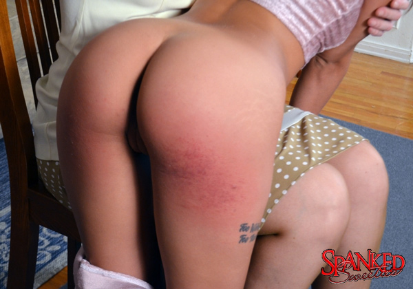 Petite Uma Jolie's wonderful round spanked bottom close-up