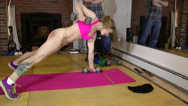 Lily continues her workout but this time with a very sore bare bottom
