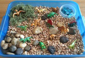 Dinosaur beans sensory bin