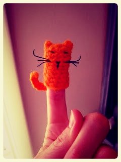 Knitted cat finger puppet for children with autism and other special needs at LE CHEMIN ABA in Paris, France.