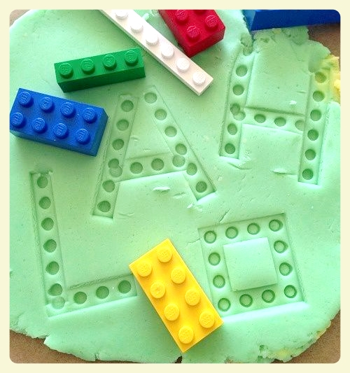 Lego stamping with playdough. Featured by LE CHEMIN ABA learning house, for children with autism and other special needs, in Paris, France.