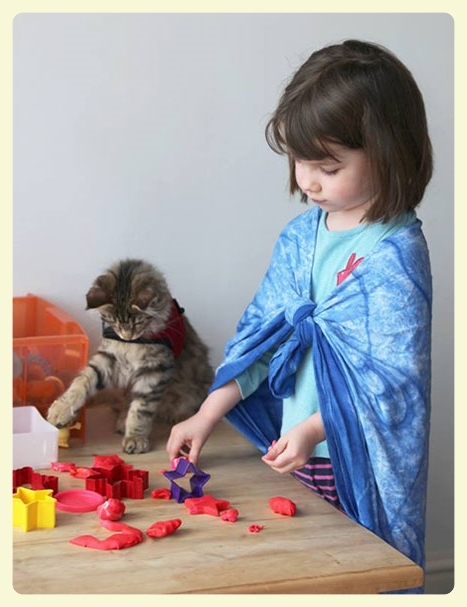 Iris Grace & Thula her therapy cat. Playing with playdough. The special bond between animals and autistic children. Featured by Special Learning House. www.speciallearninghouse.com