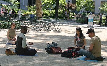 Meditating in Madison Square Park, Manhattan, ...