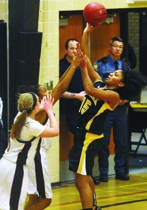 Como Park's Andrayah Adams shoots over Central's Chelcie Kizart (left) and Betsy MacDonald (far left). Photo by Mitchell Palmer McDonald