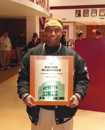 Mitchell McDonald with plaque honoring his father Kwame Photos by Charles Hallman
