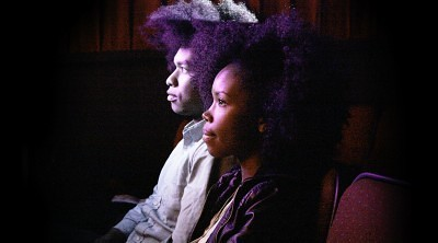 (l-r), Terence Nance as Terence and Namik Minter take in the short film Terence made in a scene from An Oversimplification of Her Beauty. Photo by Charla Harlowe, courtesy of Variance Films
