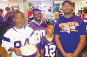 """Maalik Harut (r) of Minneapolis spent """"about $200 bucks"""" on last Sunday's Vikings game with his two sons and a family friend. Photos by Charles Hallman"""