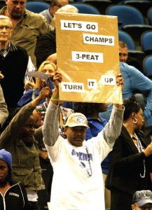 Former U of M football player Melvin Anderson, whose daughter Taylor played for Hopkins, shows his support for the Royals in the opening round of the Class 4A state tournament.