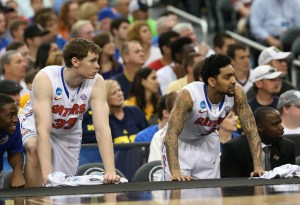 Florida Gators forward/center Erik Murphy (33) and Mike Rosario (3) react on the bench in the first half against the Michigan Wolverines during the South regional final of the 2013 NCAA Tournament at Cowboys Stadium. Mandatory Credit: Matthew Emmons-USA TODAY Sports