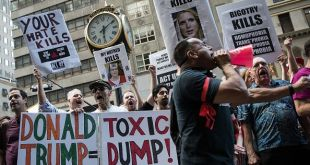 NEW YORK, NY - JUNE 21: People protesting against Republican presidential candidate Donald Trump and his policies rally outside of Trump Tower, June 21, 2016 in New York City. Trump held a private meeting with hundreds of conservative Christians and evangelical leaders today.  (Photo by Drew Angerer/Getty Images)