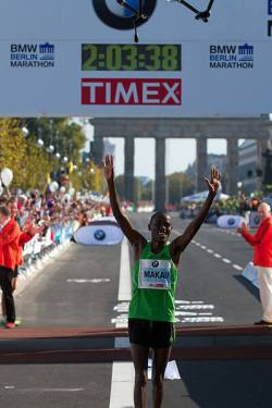 Patrick Makau breaking the World Record at the Berlin Marathon 2011. Photo copyright Christian Petersen-Clausen.