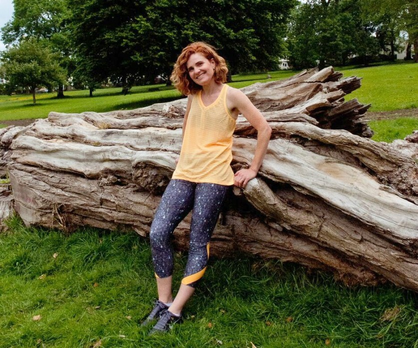 Patricia Carswell Sporty over Forty fitness leaning against log