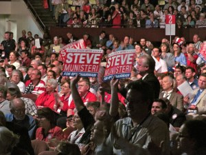 People holding signs for Steve Munisteri