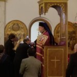 Fr. George Parsenios of St. Demetrios greets and takes a blessing from Metropolitan Evangelos at the vespers services.