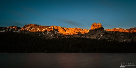 A photograph of the morning light shining on the Sierras above Lake Mary at Mammoth Lakes, California.