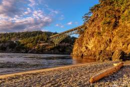 A photograph of the Summer evening glow on the North Beach at Deception Pass State Park, Washington.