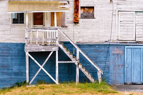 An urban photograph of the front of an old waterfront warehouse located in Anacortes, Washington.