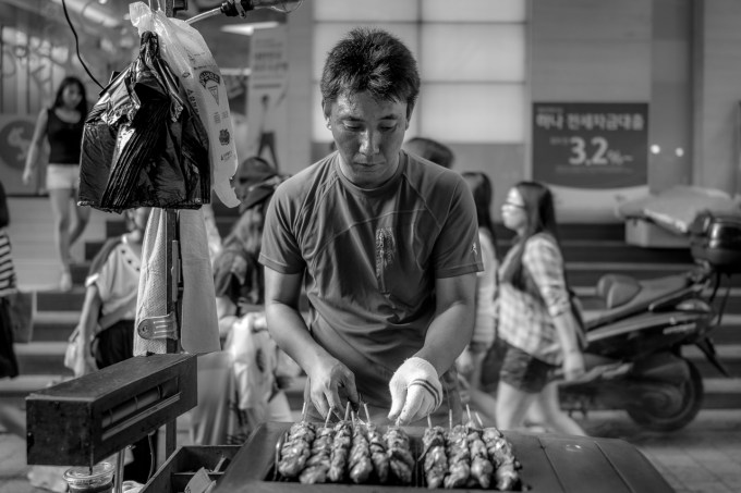 Man selling meat sticks