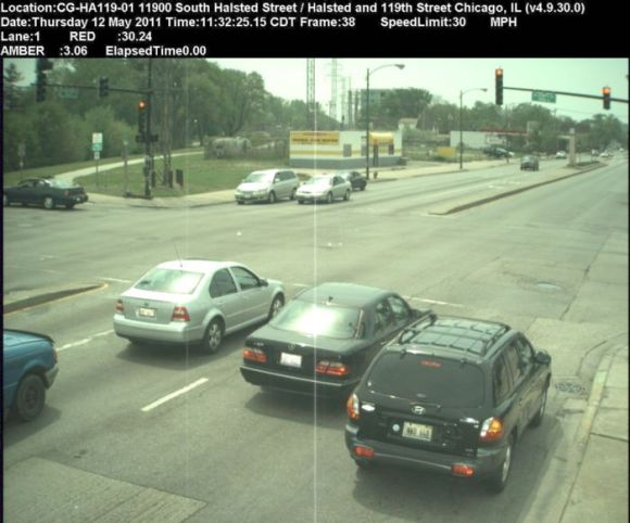 """The """"before"""" image showing the Santa Fe vehicle approaching the stop bar."""