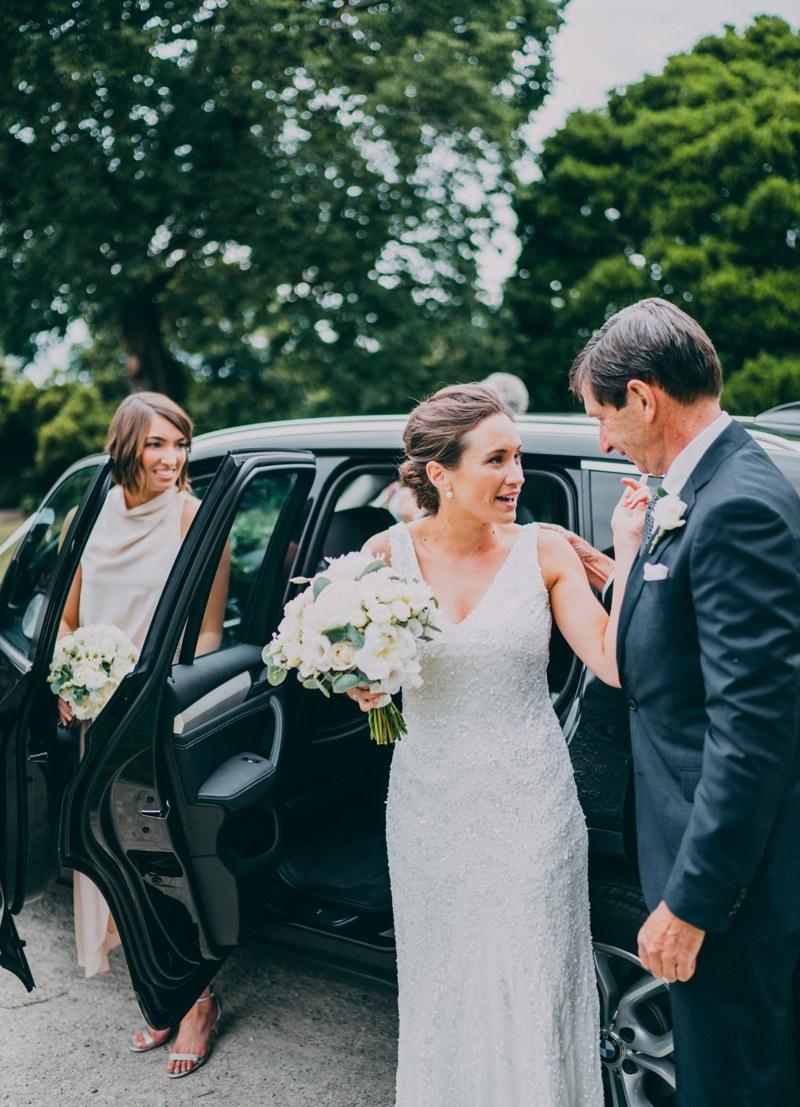 bride arriving at wedding ceremony with dad