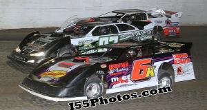Michael Kloos, Scott Weber & Tim Manville battle for the lead at Federated Auto Parts Raceway at I-55.