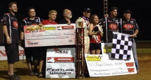 """Noblesville, Indiana's Bryan Clauson (middle) and the RKR/Curb-Agajanian crew celebrate Thursday night's """"Indiana Midget Week"""" USAC Honda National Midget feature win at Lincoln Park Speedway in Putnamville, Indiana."""